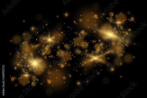 Fototapeta Set of flashes, Lights and Sparkles on a transparent background. Bright gold flashes and glares. Abstract golden lights isolated obraz na płótnie