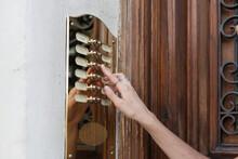 Woman Finger Pushing Door Bell...