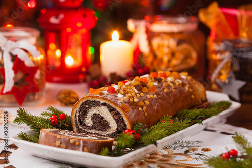 Fotografie, Obraz Poppy seed roulade in Christmas decoration