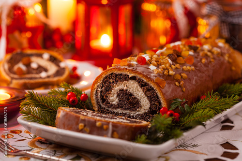 Obraz na plátně Poppy seed roulade in Christmas decoration