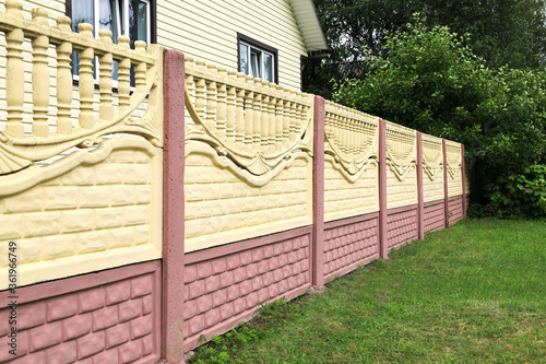 Decorative concrete fence made of blocks close-up, in a receding perspective Tapéta, Fotótapéta