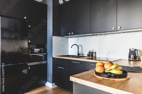 Fototapeta Kitchen in a modern studio apartment for rent. Interior design. obraz