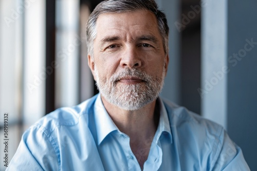 Obraz na plátně Portrait of mature business man looking at camera. Copy space.
