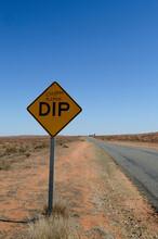 A Road Sign Between Broken Hil...