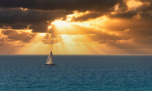 Sailing Boat During Sunrise In...