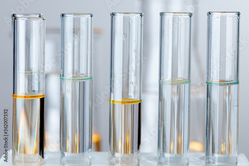Laboratory glass test tubes with transparent liquid close up