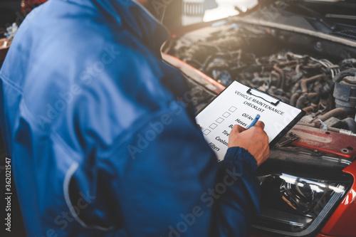 Car mechanic inspecting vehicle.  Auto inspection concept Canvas Print