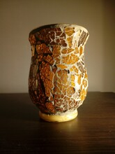 Vertical Shot Of Vase Of Broken Yellow Glass Pieces On A Table - Perfect For Decoration