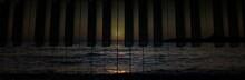 Sunset Over The Ocean Seen Through The Piano Tiles