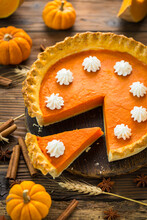 Fresh Homemade Pumpkin Pie On The Wooden Table