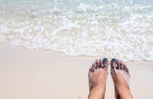 Woman Feet On Sunny Sea Beach....