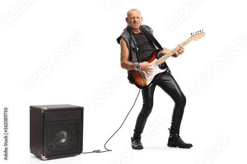 Billede på lærred Bald musician playing a guitar plugged into an amplifier