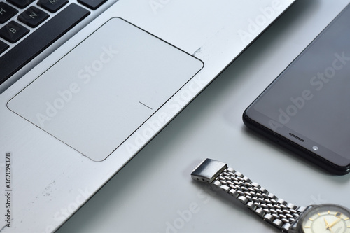 Modern white office work table with smartphone, notebook and watch flat lay Tapéta, Fotótapéta