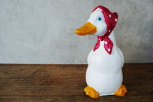 Decorative Ceramic Duck Interior Decor With Space Copy On Wooden Background