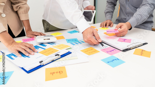 Fototapety, obrazy: business team planning startup project placing sticky notes session to share idea or brainstorm