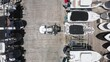 Over head view on loader carefully lifting the yacht at the multi-level boat parking. Beautiful slow motion drone video for yacht business. 4K aerial video of water transportation, Miami port, Florida