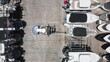 Over head view on loader gently grabs the yacht at the multi-level boat parking. Beautiful slow motion drone video for yacht business. 4K aerial video of water transportation, Miami port, Florida