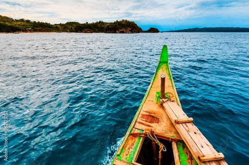 Beautiful view of calm water and ashore captured from a small wooden boat Wallpaper Mural