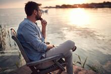 Beardy Guy Sitting Alone On A ...