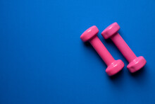Pink Dumbbell And Blue Yoga Ma...