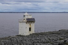 The Small Black Head Lighthouse  In County Clare Amongst The Limestone Overlooking Galway Bay.. Ireland