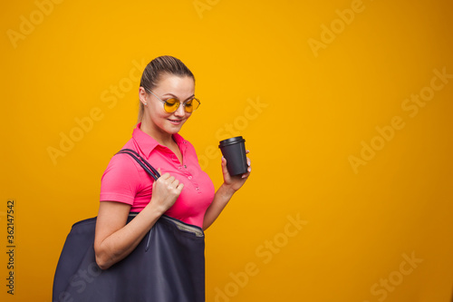 Fototapeta Business positive girl in casual style hurries on business and drinks coffee to take away. Coffee break obraz