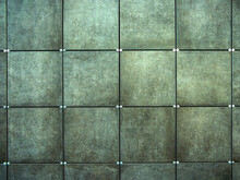Wall  Made Of Gray Square Tiles
