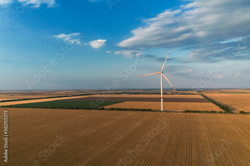 Obraz Wind turbines from aerial view. Environment and renewable energy. Aerial photography - fototapety do salonu