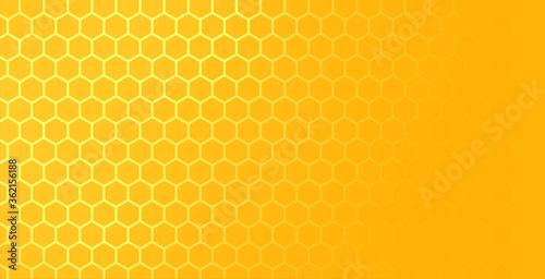 Fotografia yellow hexagonal honeycomb mesh pattern with text space