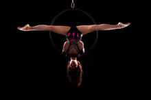 A Young Woman Doing Aerial Acr...