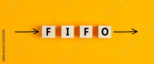 The business abbreviation fifo (first in first out) written on wooden blocks wit Canvas Print