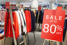 Sale Label Billbord Stand Template In Clothing Store For Sale Promotion And Discount Information For Black Friday And Holiday Season Sale. Sale Banner Template Mockup. Discount Sale Up To 80% Red Sign