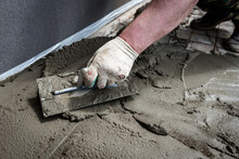 Construction Worker Troweling ...