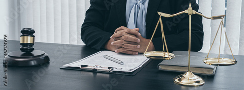 Lawyer or asian female lawyer is currently trialing and signing the documents in the room Fototapet