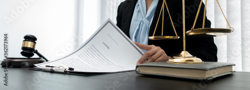 Lawyer or asian female lawyer is currently trialing and signing the documents in the room Fototapeta