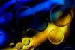 Leinwandbild Motiv Colorful artistic image of oil drop on water for modern and creation design background.