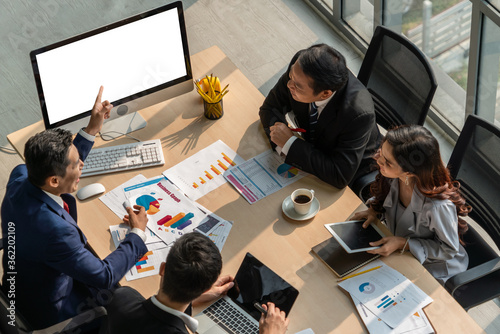 Cuadros en Lienzo Smart businessman and businesswoman talking discussion in group meeting at office table in a modern office interior