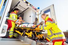 Paramedics Putting Injured Man...