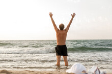Man Rejoices At The Sea Goes S...