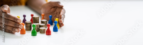 Obraz na plátně Diversity And Inclusion Concept. Hand Protecting Pawns