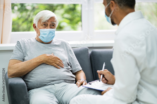 Doctor Talking To Elderly Patient - 362235324