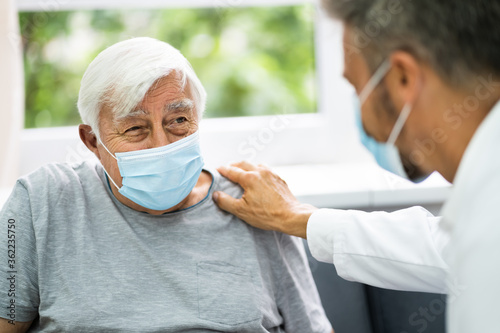 Doctor Talking To Elderly Patient - 362235750