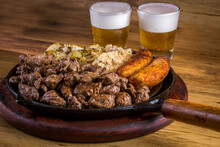 Sliced fillet Appetizer With Onion And Fried Banana. Typical Brazilian Dish