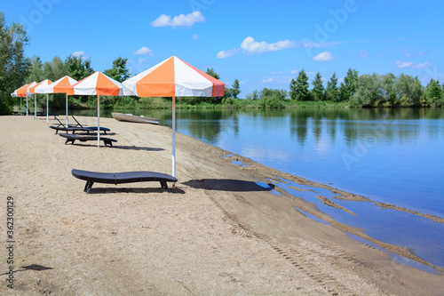 Fotografering Beach lounger with umbrella for sun protection.
