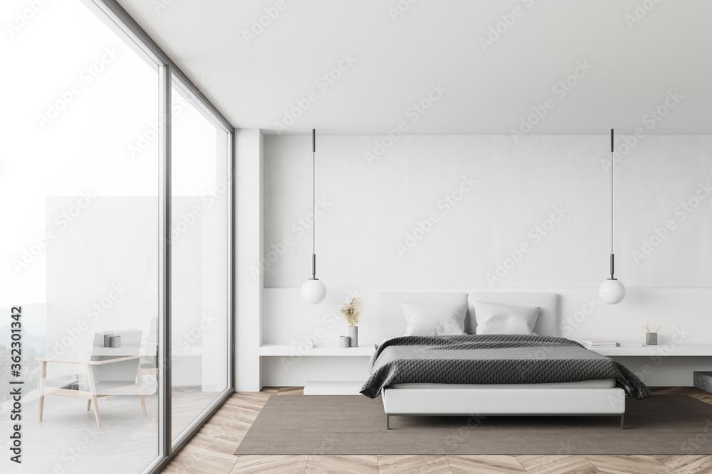 White bedroom interior with balcony