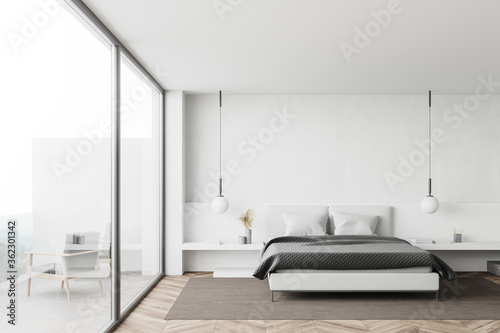 White bedroom interior with balcony