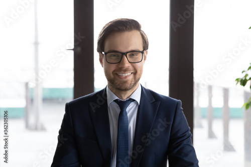 Headshot portrait of young Caucasian male director or boss in glasses posing at Fototapeta