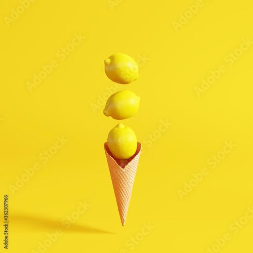 Creative lemons ice cream on yellow background.  Summer fruit