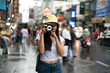 canvas print picture - Asian traveler girl with instant camera   take a photo on the street in China town Thailand.