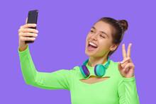 Young Happy Girl Taking Selfie...
